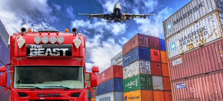 manage your supply chain - container storage with a truck and a plane above