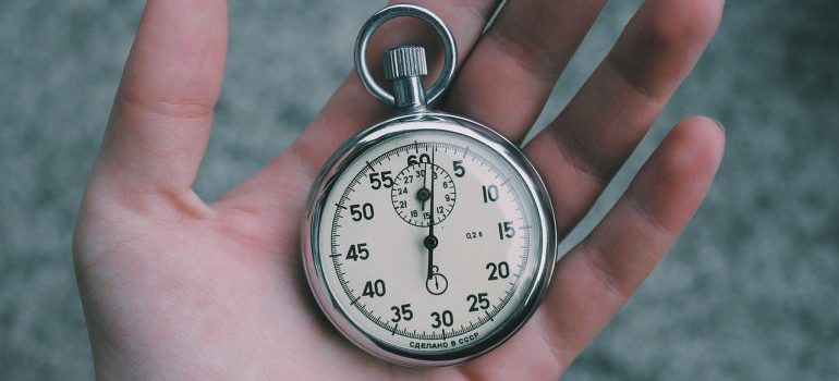 A stopwatch in a hand.