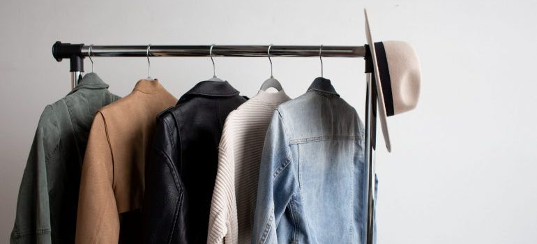 Clothes for men on a rack.