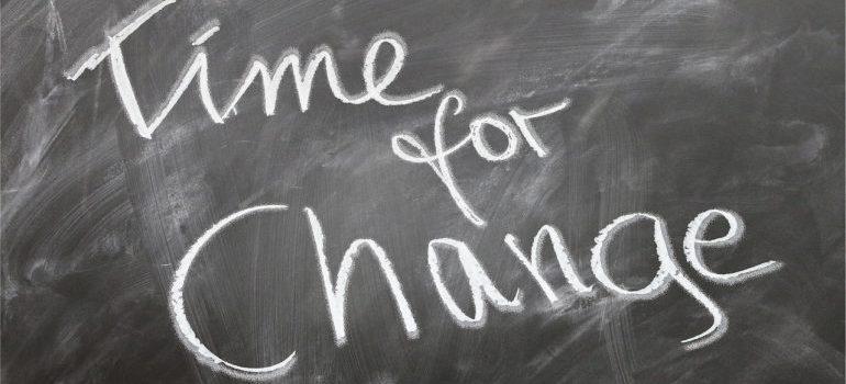 Time for change written on a blackboard.