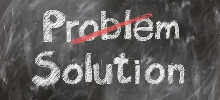 The words problem and solution on a blackboard.