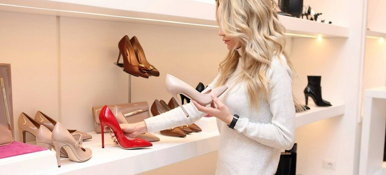 Woman looking at shoes.