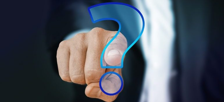 A man pointing to a question mark.